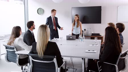 task : Young businessman and businesswoman addressing candidates on graduate recruitment day in boardroom Stock Footage