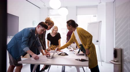 uç : Young creative business team brainstorming in a meeting room, selective focus Stok Video