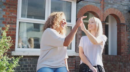 двадцатые годы : Portrait Of Two Women Standing Outside New Home  Giving Each Other High Five