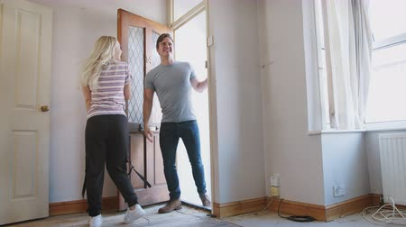 harmincas : Excited Young Couple Opening Front Door Of New Home