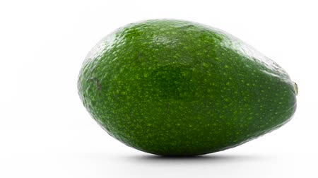 avokado : Green avocado rotates in loop at white background
