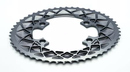 titanium : Silver oval bicycle chainring gear rotating at white background Stock Footage