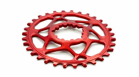 Red oval bicycle chainring gear rotating at white background Dostupné videozáznamy