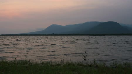 Sunset in Kampot sea coast with mountains in the background