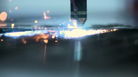 cutting up : Plasma laser cutting metal sheet with sparks Stock Footage