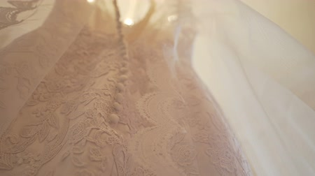 luxe : wedding dress hanging in the room