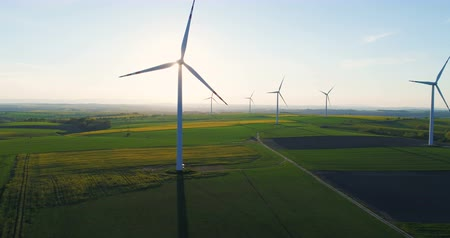 gerador : countryside with agricultural fields and wind turbines