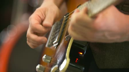 playing band : guitarist playing electrical guitar Stock Footage
