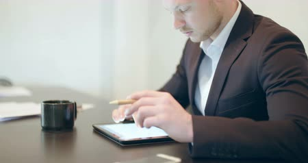 touchpad : Man using tablet in Office (finance background) Stock Footage