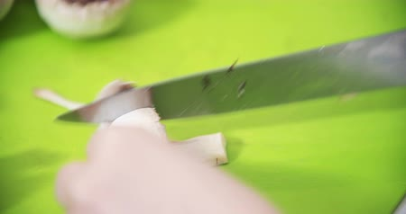 chop up : Cuting, slicing mushrooms in the kitchen for cooking Stock Footage