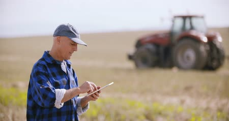 agronomist : Modern Farmer Using Digital Tablet