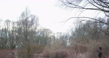 lakeshore : Man Fishing At Lakeshore In Forest Stock Footage