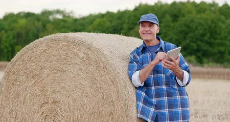 bales : Agriculture Farming Farmer Using Tablet Computer Stock Footage