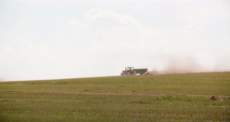 solo : Tractors Blowing Dust On Field Stock Footage