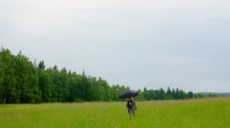 raincoat : Thoughtful Female Farmer Walking On Field Stock Footage