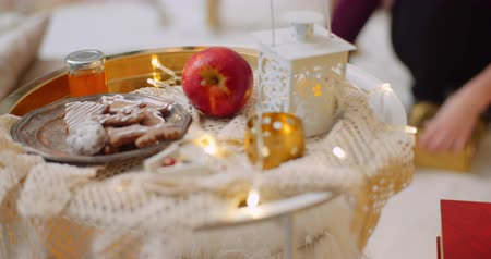 rack focus : Food And Decoration On Table With Woman Preparing Present