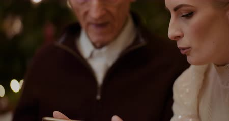 açıklayan : Woman Teaching Grandfather To Use Smartphone In Christmas