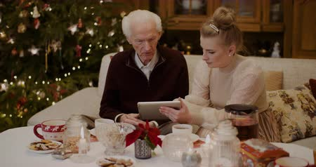 nagyapa : Grandfather Talking While Granddaughter Holding Digital Tablet
