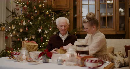 film festival : Woman Giving Christmas Present To Grandfather At Home