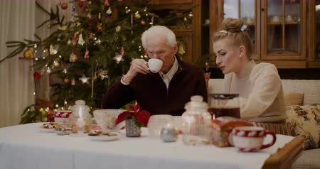 lacuna : Senior Man Talking While Granddaughter Using Phone During Christmas