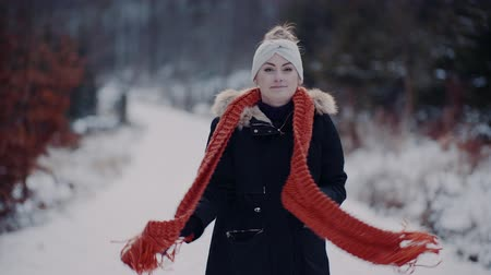 knitted gloves : woman wearing scarf on neck in winter outdoors Stock Footage