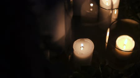 подсвечник : lit candles on black background Стоковые видеозаписи