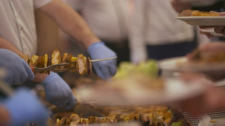 kebab : chef puts skewers on a plate