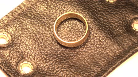 decadência : Gold Ring on Black Leather Looking sophisticated with the gold ring on black leather.