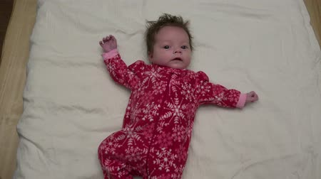 мягкость : Cute Baby In Christmas Fleece Cute baby in Christmas fleece lying on bed.