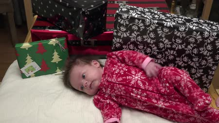 świety mikołaj : Baby With Christmas Gifts Adorable baby laying with Christmas gifts.