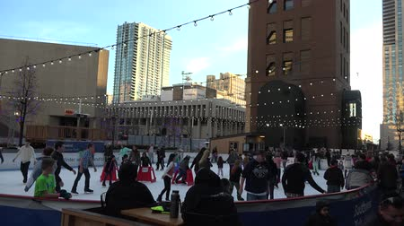 skate : Ice skating rink full of people in the middle of the city. Stock Footage