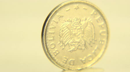 mennyiség : This 2 centavo boliviano coin in close-up shot. Stock mozgókép