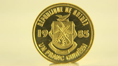 mennyiség : (Perfect Loop) Precious Guinean Coinage A precious, golden one franc coin of Guinea.