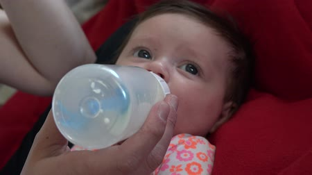 sassy : Looking down the barrel of a baby bottle.