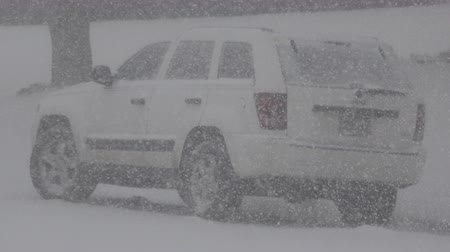 cancelado : Closeup of a jeep truck taking a lot of heavy snow. Vídeos
