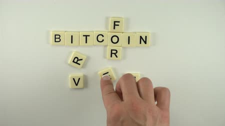 manicure : Bitcoin Forever - Spelled Out With Letter Tiles. A sexy women hand model moves alphabetical letter blocks to spell out the word Bitcoin Forever.