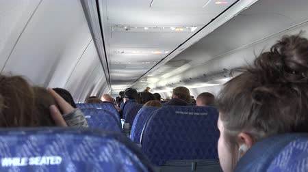 mal cheiroso : Sitting in the back of the airplane looking over the seats towards the front of the plane. Stock Footage