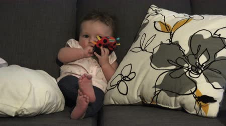 coo : Baby Seated Playing With Toys Stock Footage