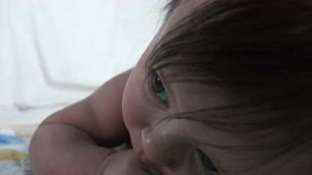 coo : Baby Head Lifting Closeup Stock Footage