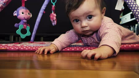 sassy : Baby Making Crawl Attempt. A sweet baby is attempting to crawl from a low angle cinematic shot. Stock Footage