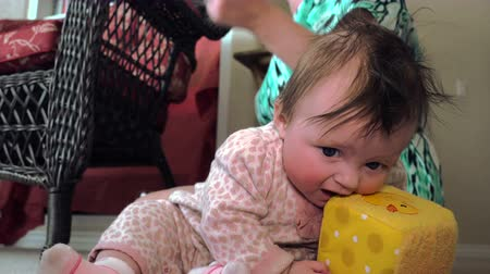 sassy : Baby Eating Play Cube. A confused baby is trying to eat a play cube instead, silly baby! Stock Footage