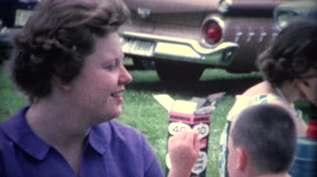 sinematografi : 8mm Vintage 1956 Women At Outdoor Party by Old Cars. A retro 8mm reel-to-reel home movie film, professionally cleaned and captured in full 4k 3840x2160 UHD resolution plus post production including color correction, deinterlace, and deflicker.