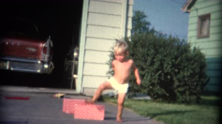 sinematografi : 8mm Vintage 1956 Boy and Girl Jumping Over Walls . A retro 8mm reel-to-reel home movie film, professionally cleaned and captured in full 4k 3840x2160 UHD resolution plus post production including color correction, deinterlace, and deflicker.