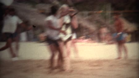 sinematografi : 8mm Vintage Women Parasailer Taking Off From Acapulco Beach 1971. A vintage 8mm reel-to-reel home movie film professionally cleaned and captured in full 4k 3840x2160 UHD resolution plus post production including color correction, deinterlace, deflicker, a
