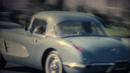 archívum : 8mm Vintage Sports Car Driving Through Hood. A vintage 8mm reel-to-reel home movie film professionally cleaned and captured in full 4k 3840x2160 UHD resolution plus post production including color correction, deinterlace, deflicker, and frame rate sync to