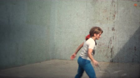 zeď : 8mm Vintage 1971 Women Playing Tennis Against Wall. A unique vintage 8mm home movie film professionally cleaned and captured in full 4k 3840x2160 UHD resolution plus post processing including retro color correction, deinterlace, and deflicker.