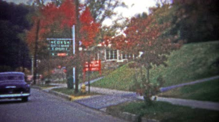 füstös : GATLINBURG, USA - 1954: Main street tour of the city known as the gateway to the Great Smoky Mountains.. Unique vintage 8mm film home movie professionally cleaned and captured in 4k 3840x2160 UHD resolution plus post processing including cinematic retro c Stock mozgókép