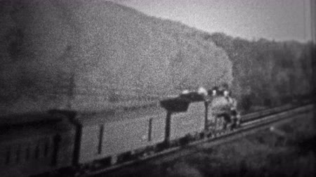 сбор винограда : CHICAGO - 1942: A coal burning train headed speeds ahead while polluting the air with thick smoke.. Unique vintage 8mm film home movie professionally cleaned and captured in 4k 3840x2160 UHD resolution plus post processing including cinematic retro color