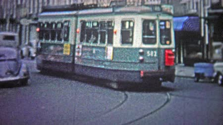 kodaň : COPENHAGEN - 1966: Street cars were a popular form of public transportation in the urban center.. Unique vintage 8mm film home movie professionally cleaned and captured in 4k 3840x2160 UHD resolution plus post processing including cinematic retro color co Dostupné videozáznamy