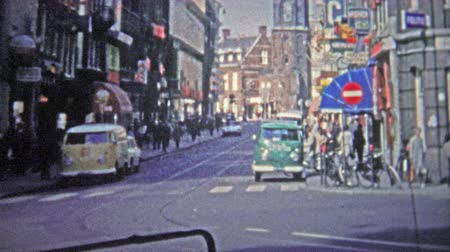 kodaň : COPENHAGEN - 1966: The mod 60s streets of a busy section of the city.. Unique vintage 8mm film home movie professionally cleaned and captured in 4k 3840x2160 UHD resolution plus post processing including cinematic retro color correction, manual speed adj